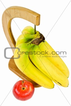 a bunch of bananas and an apple isolated on white