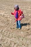 Cute child girl with ice cream playing in the field