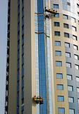 Builders on facade of building