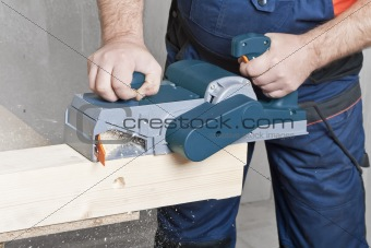 Carpenter with electric plane