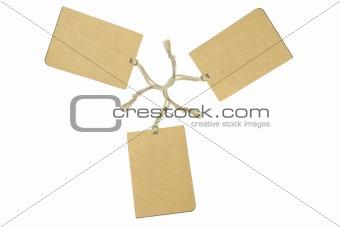 Three brown tags