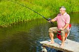 Senior man fishing