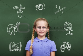 Girl by blackboard