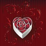 Heart shaped gift box with rose