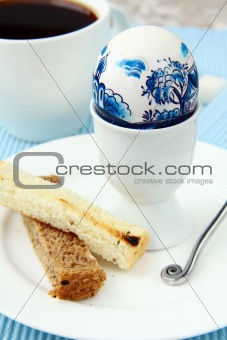 breakfast, boiled egg and coffee  on blue napkin