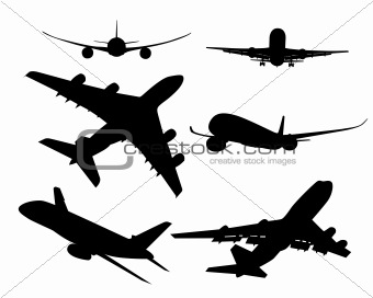 black silhouettes of passenger aircraft