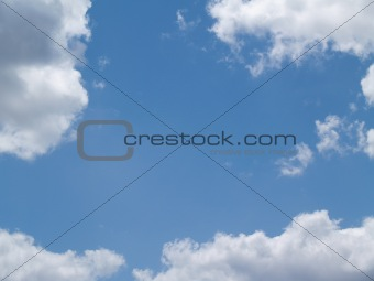 White Puffy Clouds in a Blue Sky With Copy Space