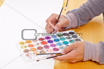 Artist Choosing a Color