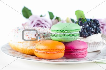 Sweets and roses on the table