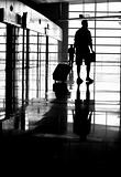 Silhouette of traveller in airport terminal