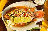 Thai food - Red snapper with garlic, chili, lemon grass and lemo