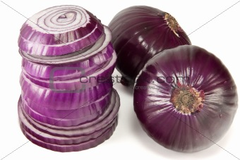 Tower of red onions with two hanging