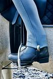 Horse riding boot in stirrup