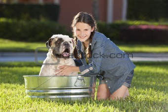 Pretty Young Girl Washing Her Pet Dog In A Tub