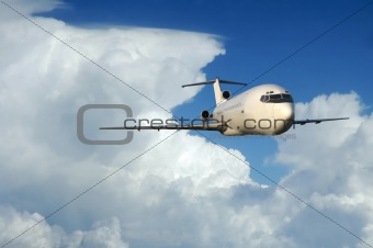 Airliner coming out of clouds