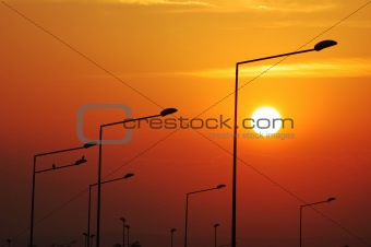 Lampposts at sunset