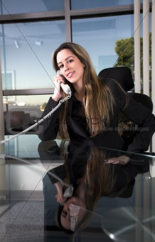 sitting at her desk