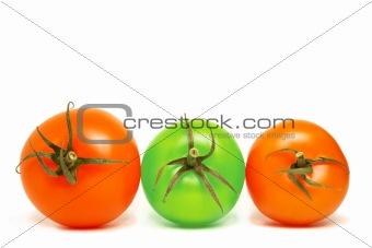 three tomatoes on white