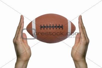 Football between two hands