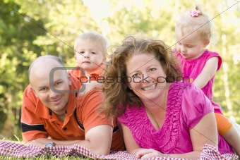 Happy Young Adorable Family with Twins Portrait in the Park.