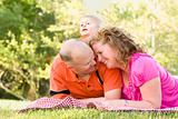 Affectionate Couple with Adorable Son in the Park.
