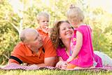 Adorable Happy Young Family with Cute Twins Enjoying a Day at the Park Together.