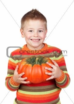 Adorable child with a big pumpkin