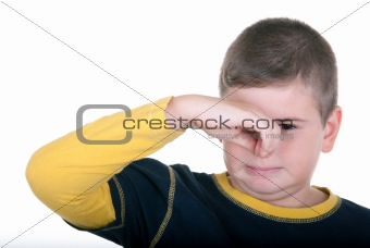Boy holds  nose