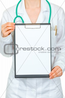 Medical female doctor holding blank clipboard in hands. Close-up.