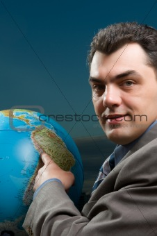 business man with globe close up
