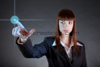 Business woman pointing on sensor screen