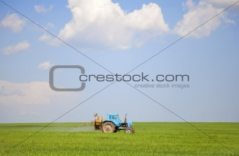 Old tractor at spring field.