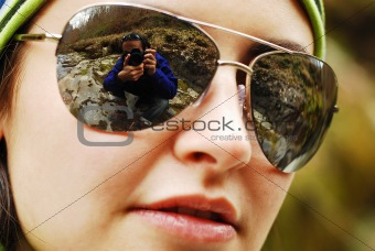 photographer in the reflection of sunglasses