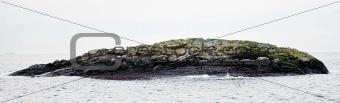 small cliff island