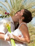 Newlyweds having a romantic kiss