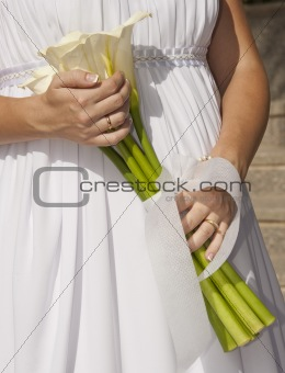 Bride holding a bunch of flowers