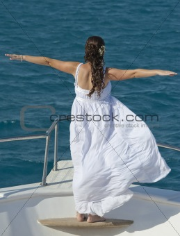 Bride on the bow of a boat