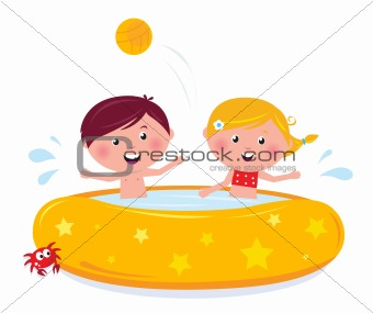 Little girl and boy splashing in the swimming pool - isolated on