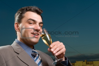 businessman with a glass of champagne close up