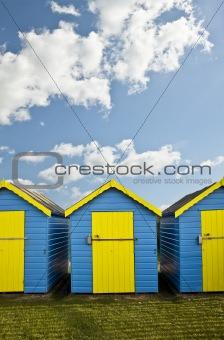 Beach Huts agsinst vibrant blue Summer sky