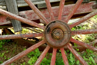 Old weathered red wagon wheel