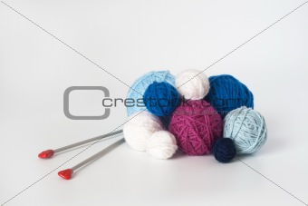 A lot of bright balls of yarn and knitting needle