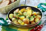 fresh potatoes fried in a pan with dill