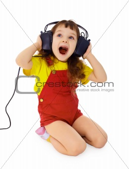 Cheerful little girl sings the music