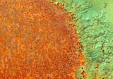 Partially rotted paint on metal surface