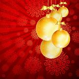 Red Christmas backdrop with gold balls.