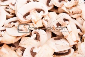 sliced mushrooms on black plate