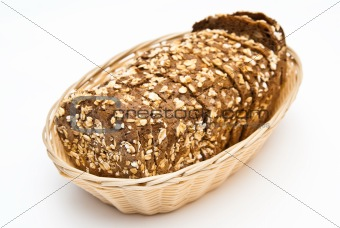 sliced wholemeal bread in wicker basket