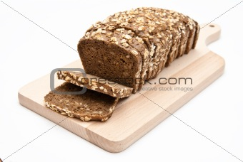 sliced wholemeal bread on kitchen board