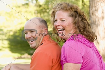 Happy Attractive Couple Laughing in the Park.